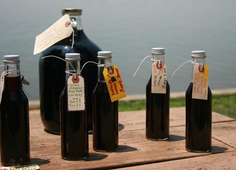 Homemade root beer in woozy bottles and a jug