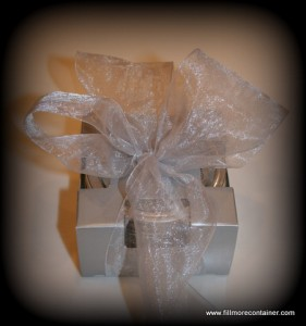 Jar in single pack box with silver bow