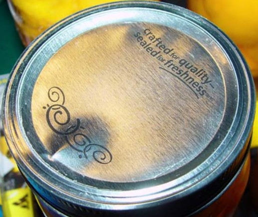 canning lid buckling